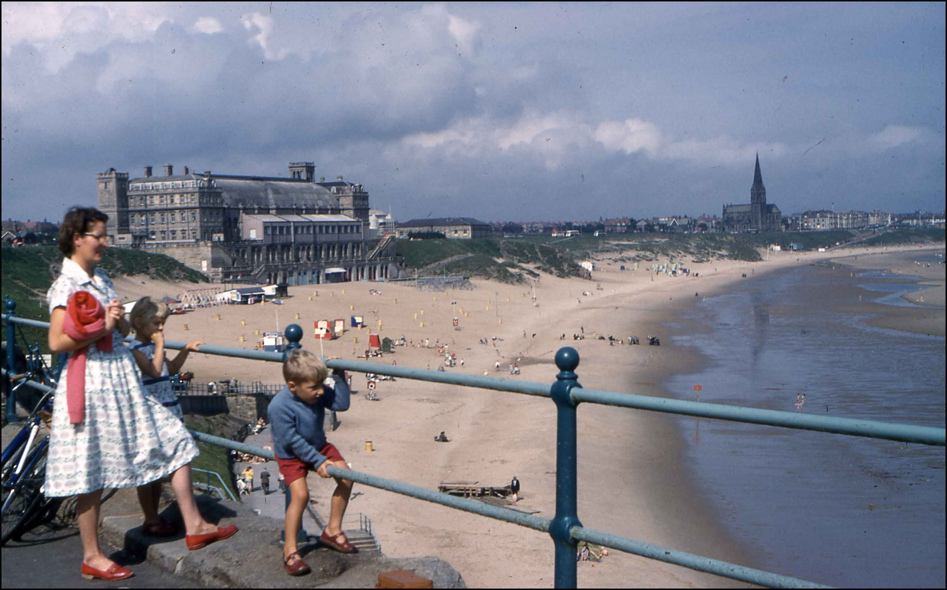 Photograph of Mother and Child at Tynemouth Long Sands with Plaza in background